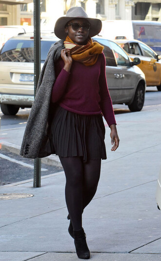 skirt sweater fall outfits ankle boots hat coat scarf lupita nyong'o