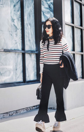 pants,white striped sweater,sunglasses,black flared pants,beige sneakers,blogger