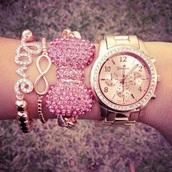 jewels,pink bracelets,pink,watch,bracelets,gold watch,diamonds,love,forever,bows,pink bow bracelet,bow jewelry,amazon,geneva