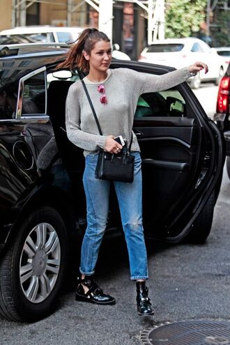 sweater bella hadid celebrity style celebrity model jeans blue jeans grey sweater bag black bag ysl bag ysl sunglasses mirrored sunglasses boots black boots