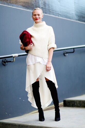 sweater sweater over dress tumblr white sweater turtleneck turtleneck sweater white dress high low dress asymmetrical asymmetrical dress ruffle ruffle dress boots black boots over the knee boots bag furry pouch pouch red bag streetstyle pointed toe boots