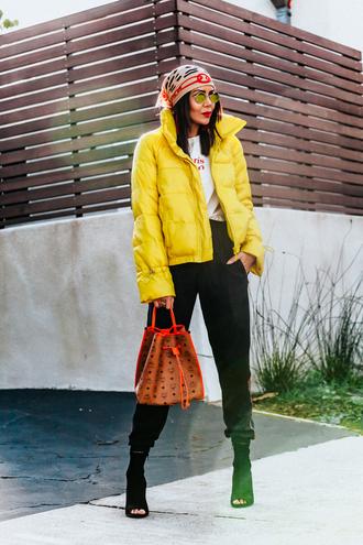 stuffshelikes blogger jacket pants shoes scarf t-shirt bag sunglasses yellow jacket bucket bag mcm bag peep toe boots winter outfits