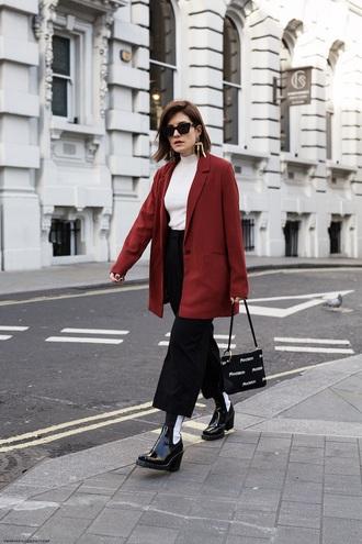 jacket rust top white top white turtleneck black pants cropped pants black boots blazer turtleneck pants boots sunglasses