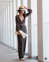jumpsuit,tumblr,stripes,striped jumpsuit,long sleeves,long sleeve jumpsuit,plunge v neck,v neck,necklace,gold necklace,jewels,jewelry,gold jewelry,bag,pouch,metallic,hat,sun hat,spring outfits,date outfit