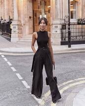 pants,black pants,wide-leg pants,high waisted pants,sleeveless top,earrings,shoulder bag
