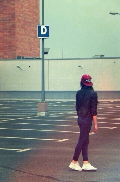 black jacket red hat white shoes jeans