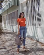 pants,jeans,denim,high wasted denim jeans,orange shirt,big bag,bag,grey bag,sunglasses,shoes,top,orange top,round sunglasses