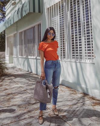pants jeans denim high wasted denim jeans orange shirt big bag bag grey bag sunglasses shoes top orange top round sunglasses
