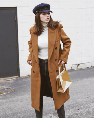 coat hat tumblr camel camel coat top white top turtleneck white turtleneck top fisherman cap jeans black jeans