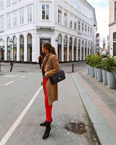 coat brown coat pants red pants shoes black shoes