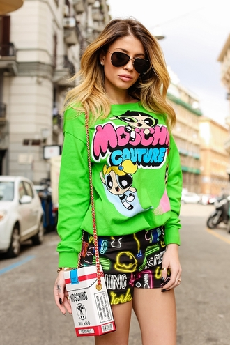 chiara nasti blogger green sweater cartoon black shorts moschino
