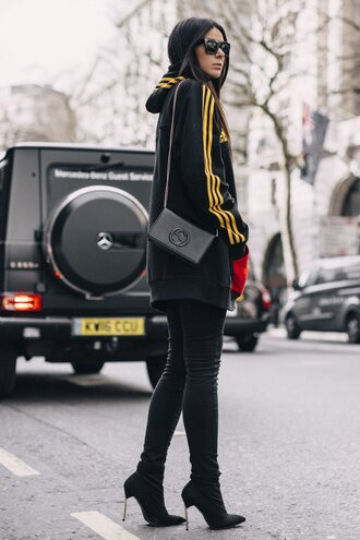 jeans london fashion week 2017 fashion week 2017 fashion week streetstyle black jeans skinny jeans boots black boots high heels boots sunglasses black sunglasses sports jacket bag black bag chain bag mini bag