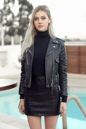 skirt,nicola peltz,celebrity,celebrity style,all black everything,actress,leather skirt,black skirt,mini skirt,top,black top,turtleneck,long sleeves,jacket,leather jacket,black jacket,blonde hair