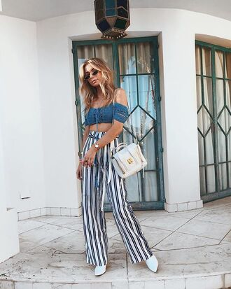 top pants wide pants stripes bag white bag blue top knitted top shoulder bag off the shoulder top white shoes white booties sunglasses