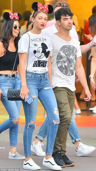 make-up lipstick red lipstick red gigi hadid t-shirt top mickey mouse jeans sneakers minnie mouse hair accessory headband light blue jeans ripped