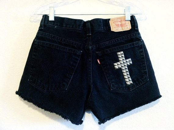 These black high-waist shorts from Blackheart have a cool silver tone star stud pattern across the front for a little edge and lots of fashion. They have a raw hem, 5 .