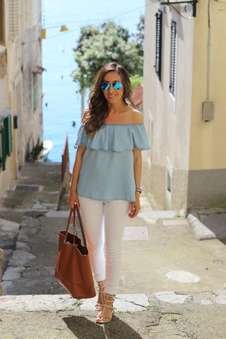 lilly's style blogger shoes bag sunglasses jewels off the shoulder blue top white jeans white pants brown bag aviator sunglasses nude heels blue off shoulder top blue sunglasses top off the shoulder top jeans ruffle ruffled top sandals flat sandals nude sandals