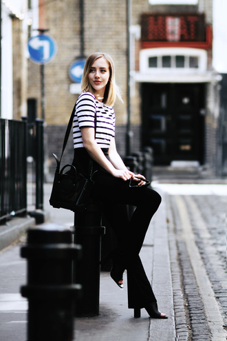 framboise fashion blogger striped top black pants black bag