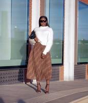 skirt,midi skirt,pleated skirt,snake print,sandals,high heel sandals,sweater,knitted sweater,earrings,clutch