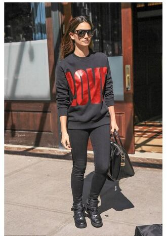 sweater sweatshirt love lily aldridge boots leggings model off-duty sports sweater black sweater black jeans all black everything celebrity style celebrity black bag black sunglasses givenchy
