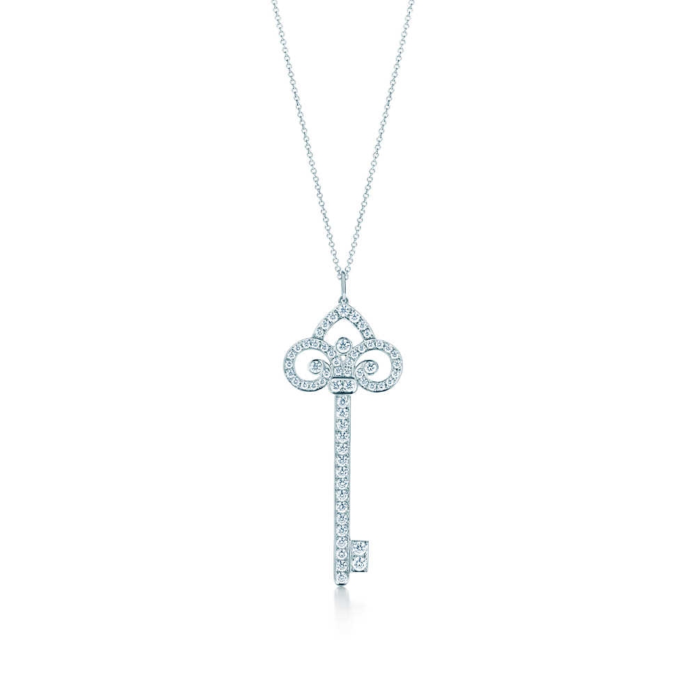 Tiffany Keys fleur de lis key pendant in platinum with diamonds on a chain.              