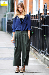 pants,fashion week street style,fashion week 2016,fashion week,london fashion week 2016,green pants,cropped pants,wide-leg pants,sneakers,low top sneakers,gold sneakers,shirt,blue shirt,fall outfits,streetstyle