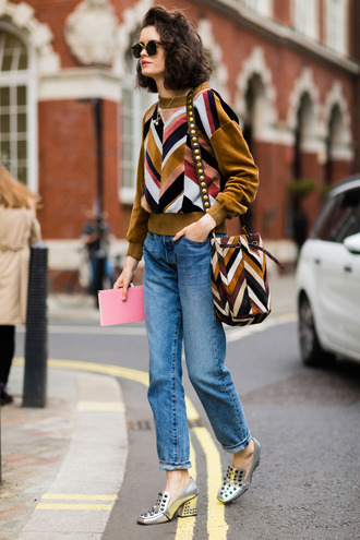 fashion week street style fashion week 2016 fashion week london fashion week 2016 mustard mustard sweater printed sweater chevron bag bucket bag printed bag shoes silver shoes thick heel block heels denim jeans blue jeans mom jeans fall outfits streetstyle fall colors shoulder bag pilgrim shoes high heel loafers thanksgiving outfit