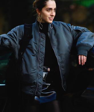 jacket tumblr bomber jacket khaki bomber jacket army green jacket skirt mini skirt black skirt leather skirt black leather skirt vinyl vinyl skirt top black top black turtleneck top turtleneck fashion week 2017 streetstyle hoop earrings earrings jewels jewelry