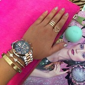 jewels,ring stack,ring,heart jewelry,michael kors,cartier,bracelets,cuff,gold jewelry