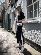 style and minimalism,blogger,dress,jeans,bag,sunglasses,jewels,navy dress,metallic bag,sneakers,dress over pants,spring outfits