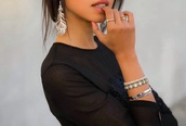 jewels,earrings,peacock feather,silver,peacock,feathers,jewelry,bracelets,stacked bracelets,silver bracelet,feather earrings,sunglasses,black sunglasses,bling,crystal