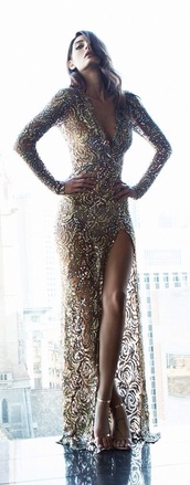 dress,neutral dress,sequin dress,gold sparkly prom dress,steven khalil,long sleeve dress,sequin prom dress,gold prom dress,gorgeous dress,leg split,low v neck,low cut dress,gold dress,gold sequins,long prom dress,golden prom dress,shiny dress,gold,long dress,prom dress,prom,prom gown,elegant,evening dress,gold long dress,golden long dress belt dress,girl,girly,beautiful,blanket needed as well,gold long night dress,sequins,sparkle,demure,golden gown,long evening dress,2016,thigh highs,long sleeves
