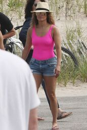 swimwear,jennifer lopez,summer outfits,summer,beach,flat sandals,flats,hat,sunglasses,shorts,one piece swimsuit