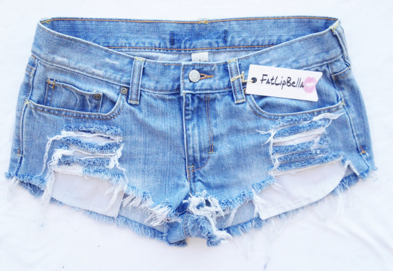 distressed shorts with showing pockets frayed door ZamGhuden