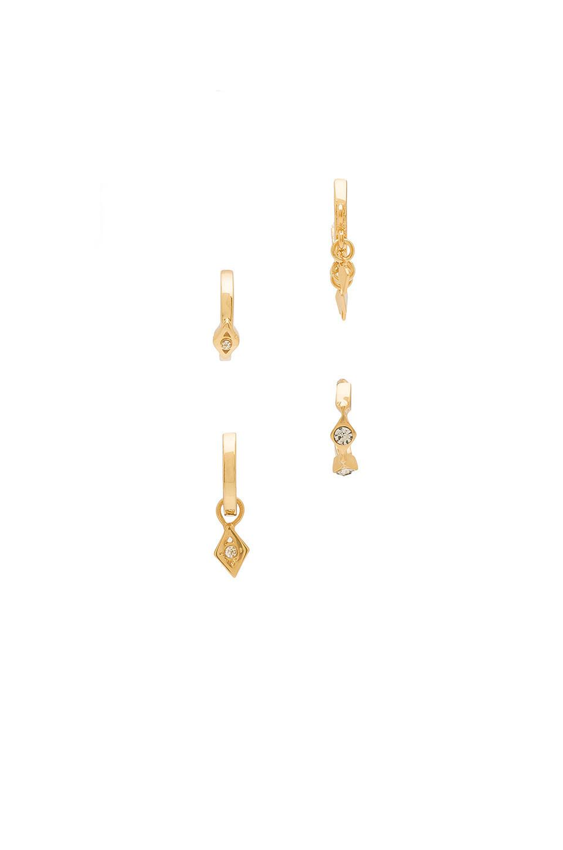 Luv AJ Evil Eye Hoop Huggie Earrings in gold / metallic