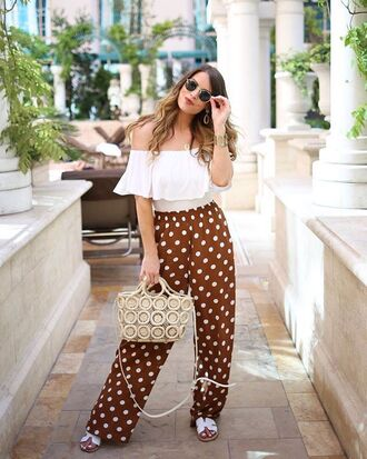 top white crop tops polka dots pants brown pants crop tops white top polka dots bag shoes sandals black or white sandals sunglasses off the shoulder top