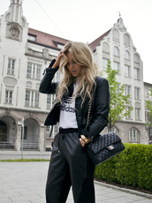 pants,adidas,chanel,black,edgy,blonde hair,sportswear,gold,bag