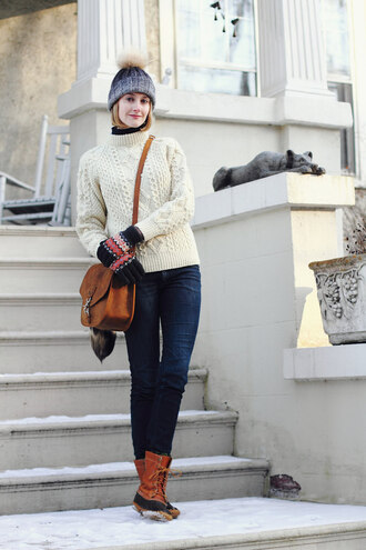 district of chic blogger hat sweater gloves jeans shoes bag knitted gloves winter outfits winter look cable knit white cable knit sweater white sweater turtleneck turtleneck sweater brown bag grey beanie beanie pom pom beanie denim blue jeans winter boots boots brown boots