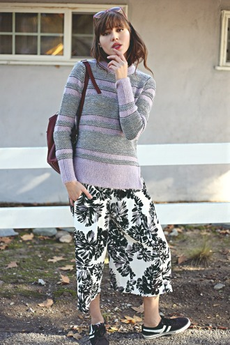 natalie off duty blogger sneakers winter sweater culottes tropical sweater shoes sunglasses back to school grey sweater palazzo pants floral pants black sneakers