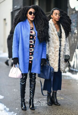 shoes floral top nyfw 2017 fashion week 2017 fashion week streetstyle patent shoes patent boots black boots boots over the knee boots over the knee top floral coat blue coat bag white bag white coat fur coat white fur coat denim jeans denim culottes culottes blue bag ankle boots sunglasses clear lens sunglasses gloves