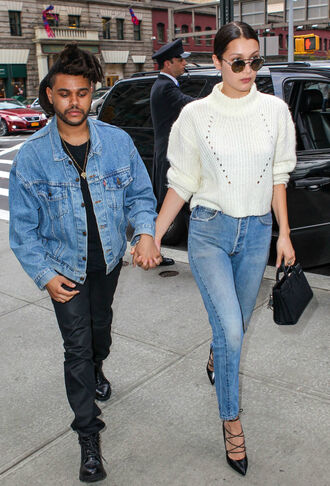 sweater bella hadid celebrity model celebrity style the weeknd singer white sweater sunglasses bag black bag sandals high heel pumps black pumps menswear mens jacket denim jacket mens pants mens boots