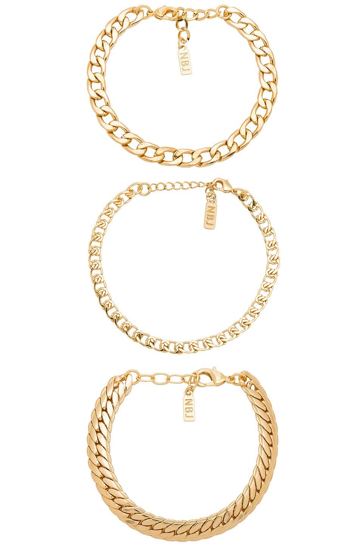 Natalie B Jewelry Tre Catena Bracelet in gold / metallic