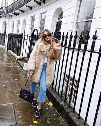 coat tumblr fur coat nude coat denim jeans blue jeans sneakers black sneakers bag black bag sunglasses