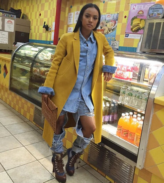 jeans ripped jeans fashion week 2016 streetstyle karrueche coat mustard shirt denim denim shirt boots ny fashion week 2016 shoes