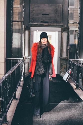 natalie off duty blogger black beanie red coat fur scarf