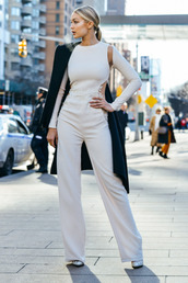 jumpsuit,cut-out,palazzo jumpsuit,white jumpsuit,long sleeves,classy,pointed toe pumps,pumps,white pumps,coat,black coat,gigi hadid,celebrity style,celebrities in white,celebrity,model