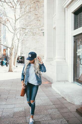 hat black cap cap denim jacket jacket blue jacket jeans blue jeans ripped jeans top striped top bag brown bag sneakers grey sneakers sporty