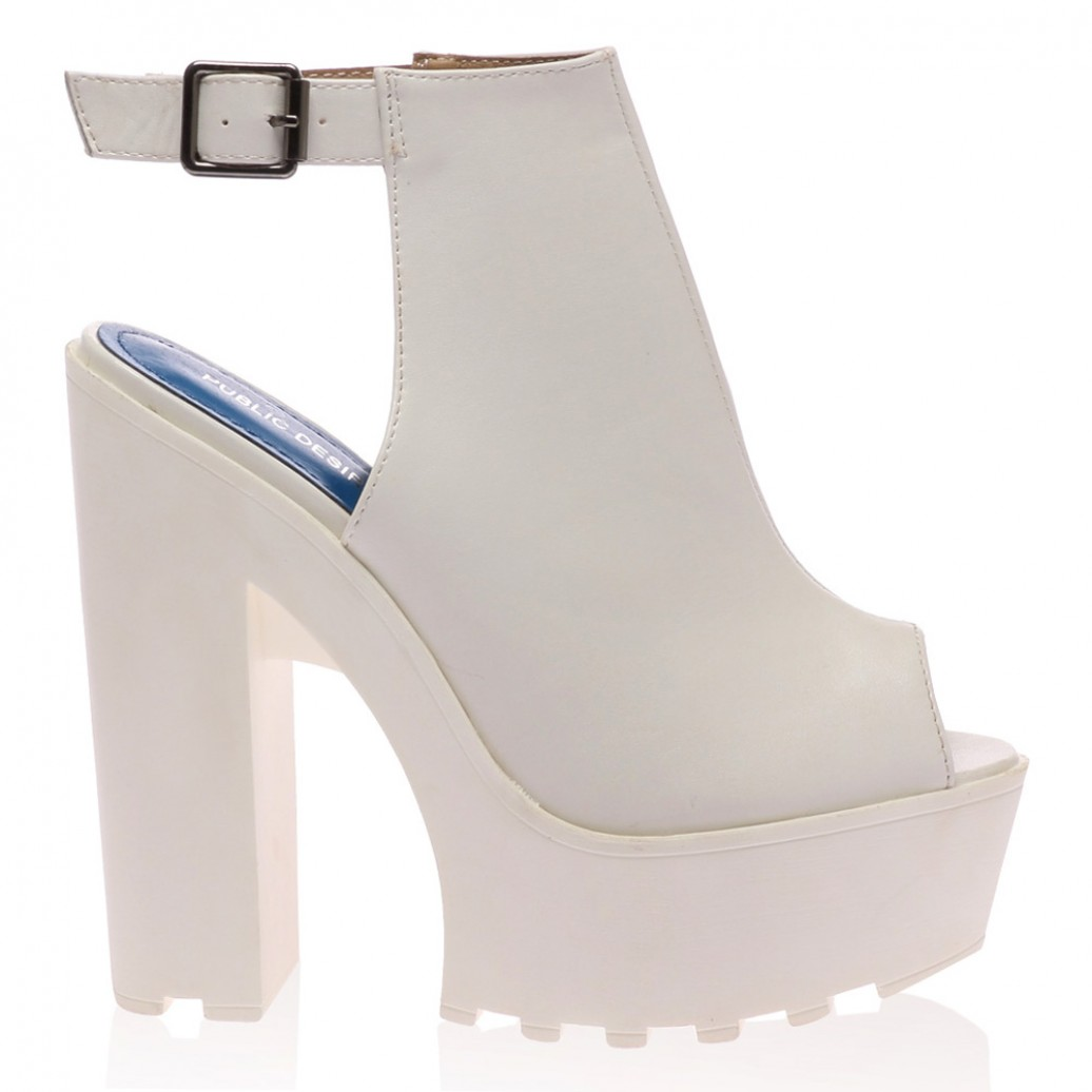 Harper white high heeled cleated sole platforms