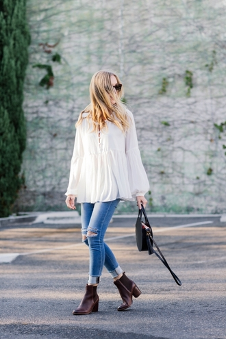 blouse tumblr white blouse white top puffed sleeves denim jeans blue jeans ripped jeans cuffed jeans boots brown boots thick heel block heels bag black bag