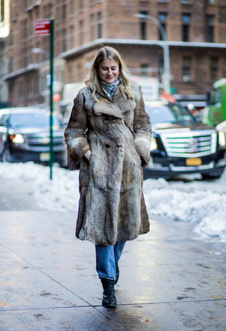 coat nyfw 2017 fashion week 2017 fashion week streetstyle fur coat long fur coat big fur coat denim jeans blue jeans boots black boots scarf winter outfits winter look